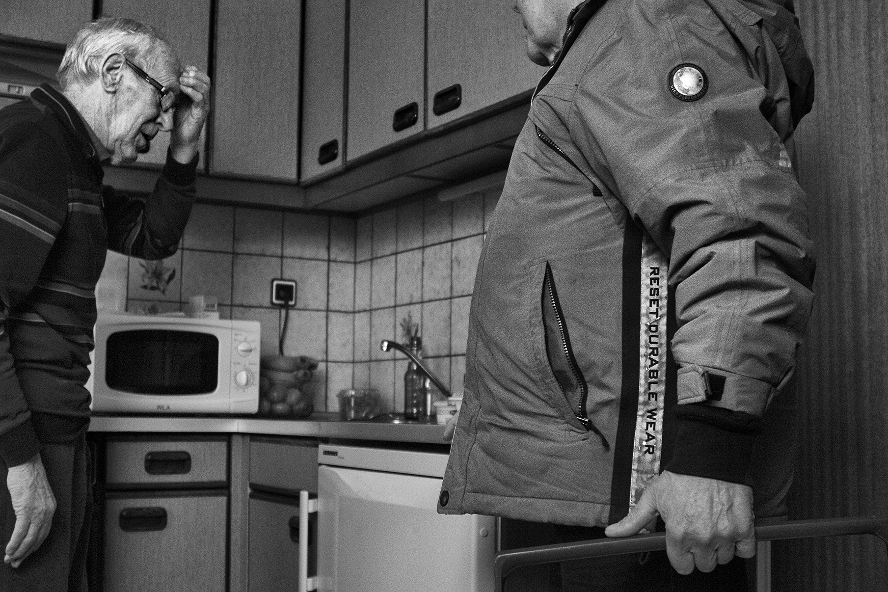 Silent Heroes Dad in Kitchen - Documentary Photographer